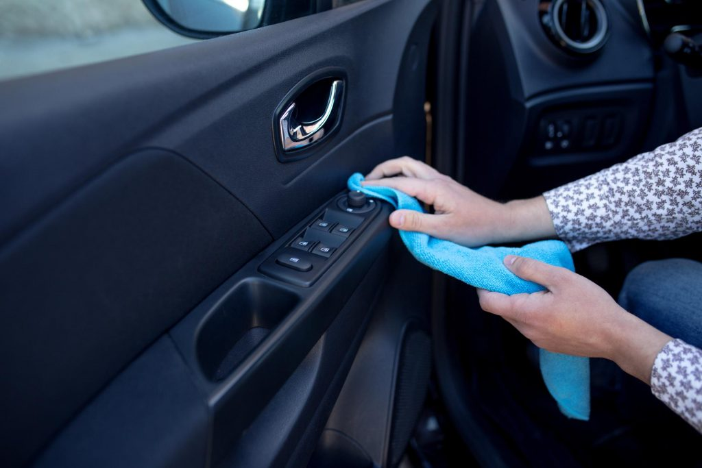 unrecognized person cleaning the car lock controller
